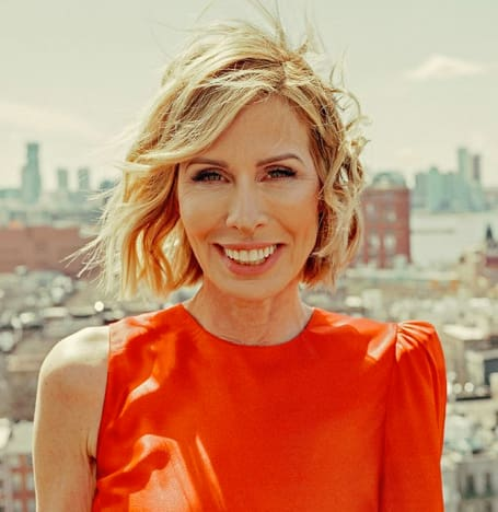 Carole Radziwill Wears Orange