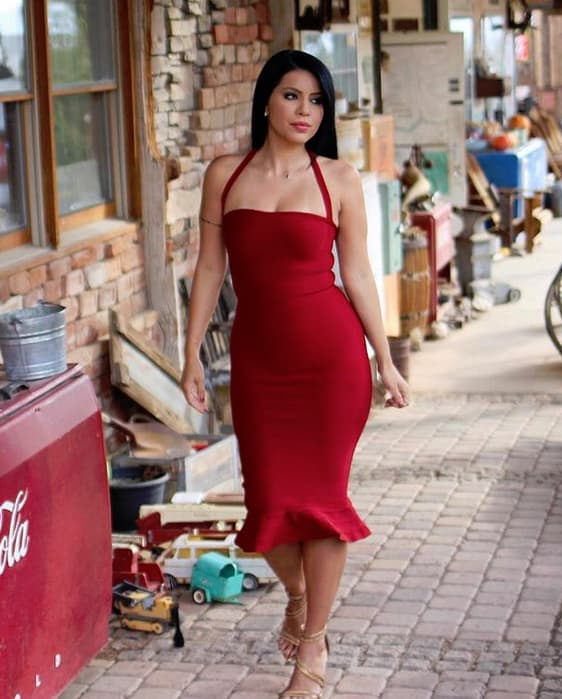 Larissa lima models a red dress