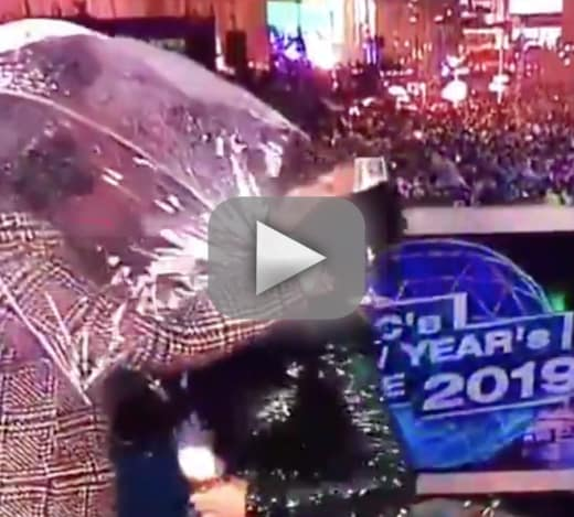 Chrissy teigen gets clocked in the face by umbrella on new years
