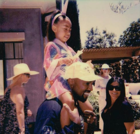 North West Rides on Kanye West's Shoulders