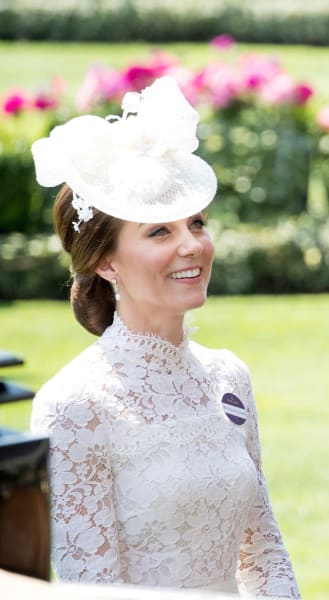Kate Middleton Smiles in White