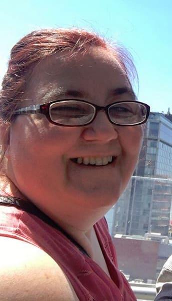 Danielle mullins smiles in the sunlight