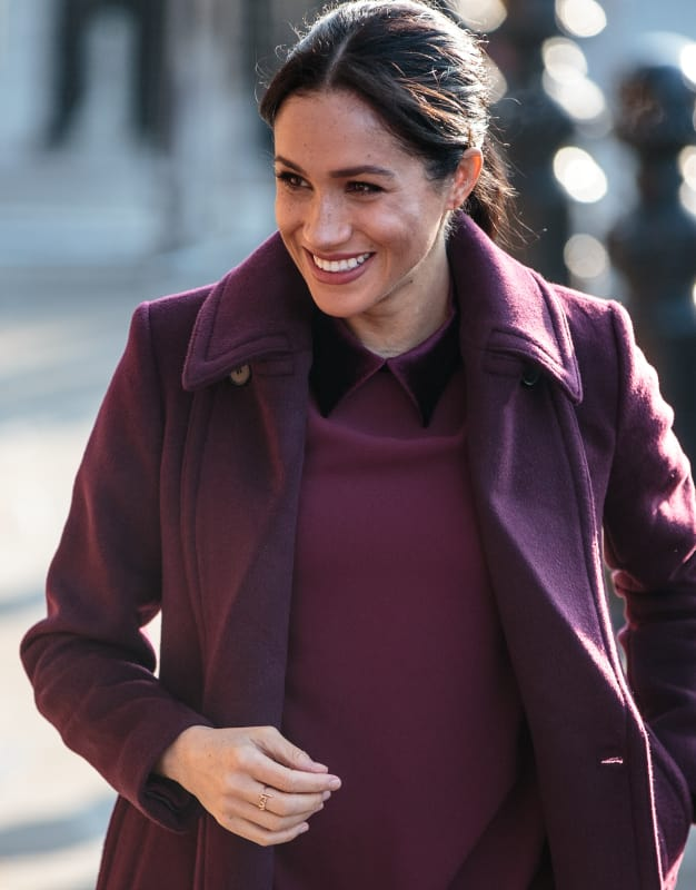 Meghan markle with a big smile