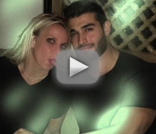 Britney spears and sam asghari cuddle up in intimate video
