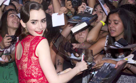 Lily Collins Signs
