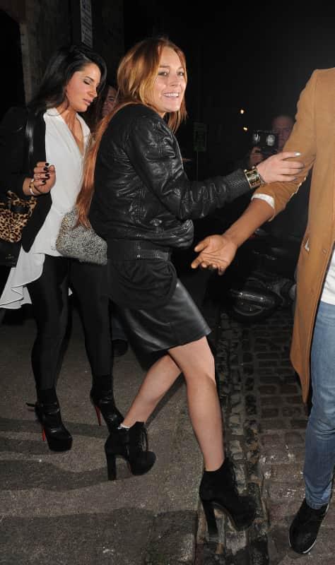 Lindsay Lohan Stumbles in London
