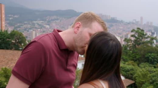 Tim Clarkson and Melissa Zeta kiss as deposit