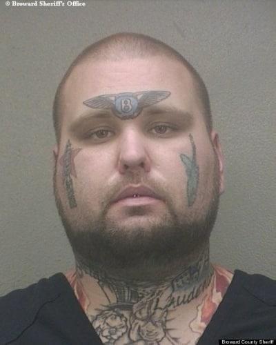 Man with Bentley Tattoo Mug Shot