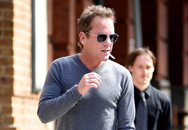 Kiefer Sutherland smoking a cigarette (or weed)