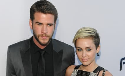 Miley Cyrus: Posing with Liam Hemsworth at Paranoia Premiere