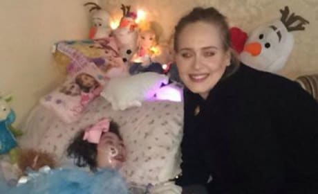 Adele visits young fan with cerebral palsy