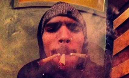 Chris Brown Smokes Three Joints at the Same Damn Time in Amsterdam