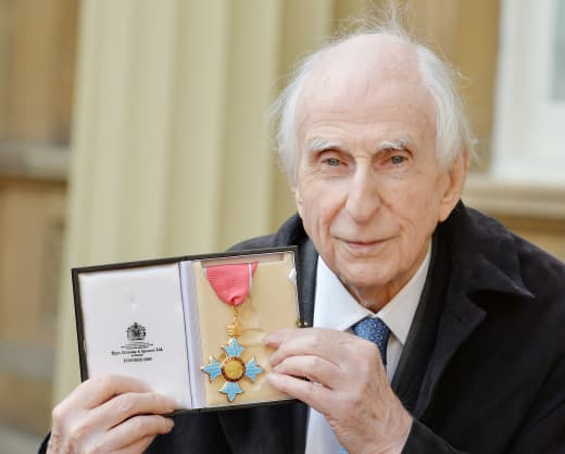 Michael Bond with his Order of the British Empire