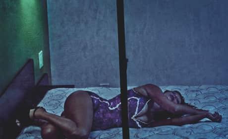 Kim Kardashian on a Bed