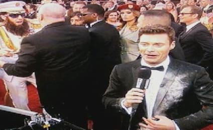 Sacha Baron Cohen Spills Kim Jong Il Ashes on Ryan Seacrest [Video]