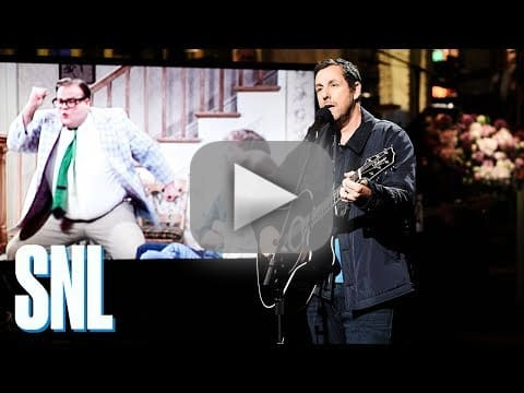Adam sandler tears up performing touching song for chris farley