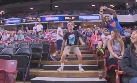 Young Fans Dances Up Happy Storm at Preseason NBA Game