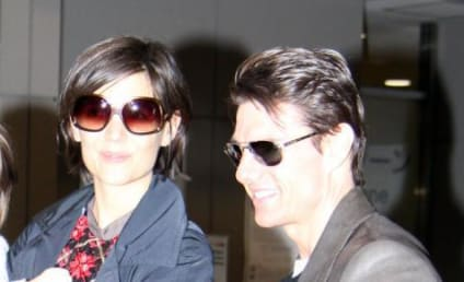 Tom Cruise Keeps His Woman On a Tight Leash