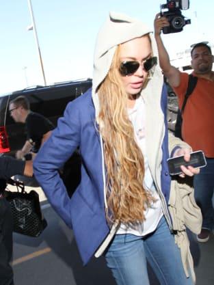 Lindsay Lohan Ducks Away