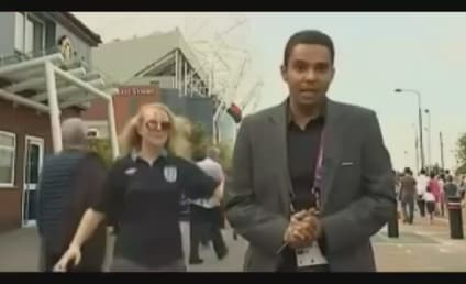Olympic Reporter Kiss: Soccer Fan Lays One On During Live Broadcast