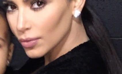 Kim Kardashian Krops Daughter Out of Selfie