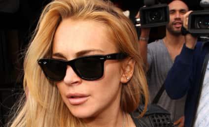 Lindsay Lohan Calls 911 on Shady Photographer