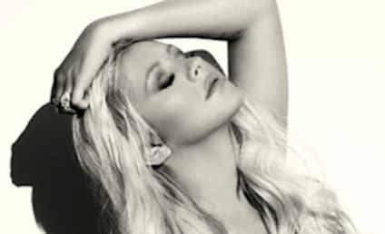 Christina Aguilera Posts Topless Selfie, Sparks Implant Rumors