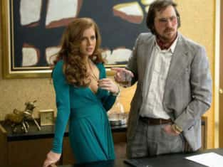 Amy Adams and Christian Bale in American Hustle