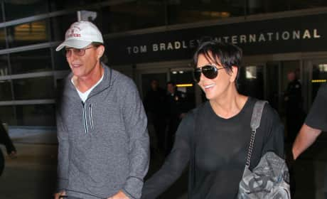 Bruce and Kris Hold Hands