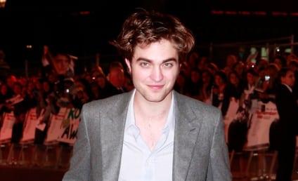 Robert Pattinson and Kristen Stewart Win Big, Kiss (!!!) at MTV Movie Awards