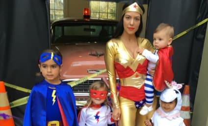 Kourtney Kardashian for Halloween: Super Cleavage, Super Kids!