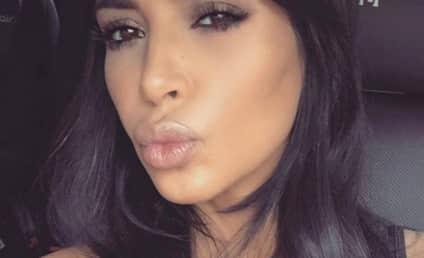 Kim Kardashian Hits Facebook Milestone, Puckers Up for Fans