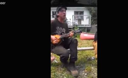 Man Performs Original Song, Dedicates Track to Bottle of Beer
