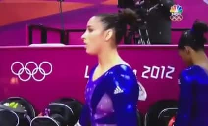 Aly Raisman Parents Cheer, Wince, Squirm, Worry During Olympic Routine [Video]
