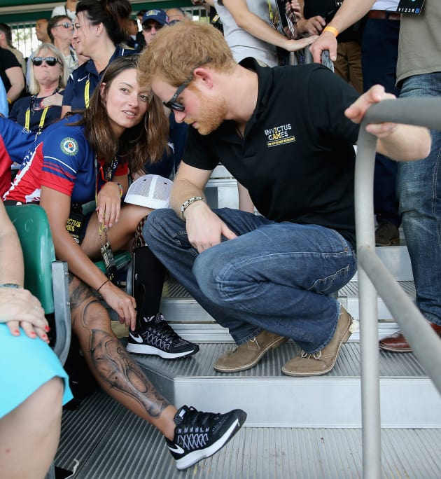 Prince harry flirts with swimmer elizabeth marks at for Can you go swimming after getting a tattoo