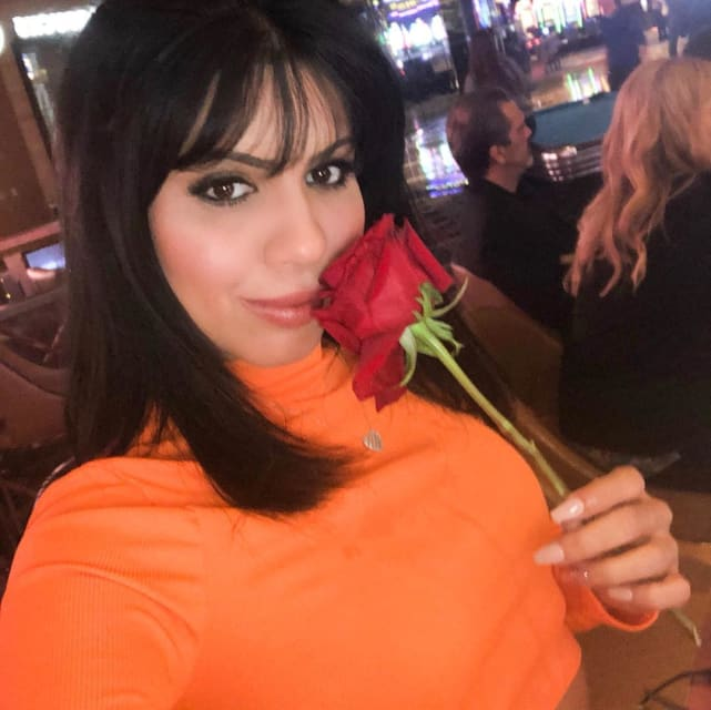 Larissa lima with a rose