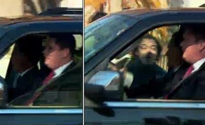 Romney Heckler Arrested For Charging Motorcade