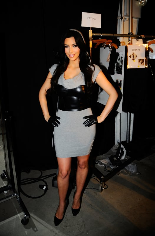 Kim kardashian poses backstage at the bebe kardashian fall 2010