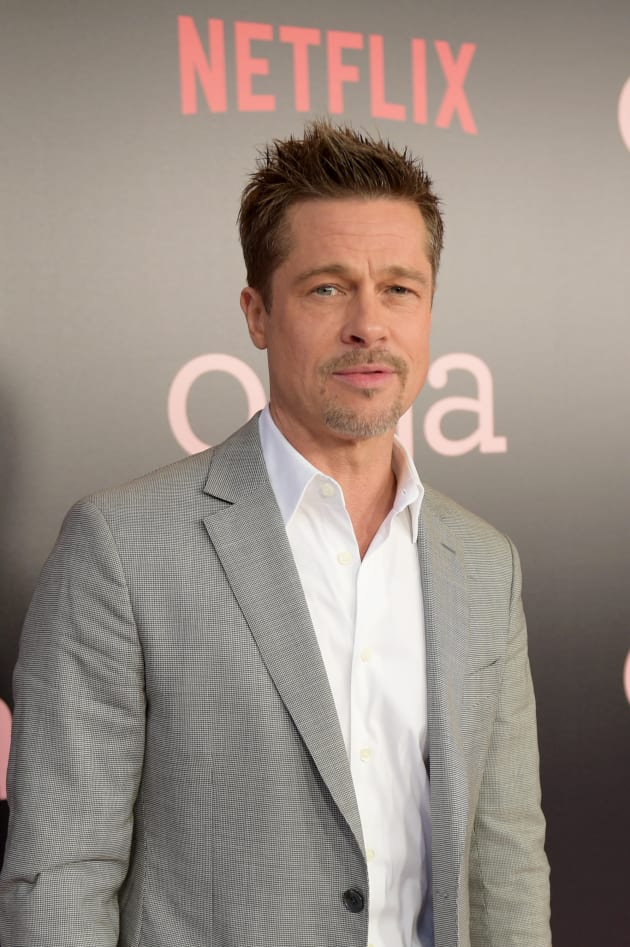Brad Pitt Smolders