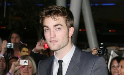 Breaking Dawn Premiere-Off: Robert Pattinson vs. Taylor Lautner