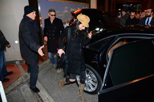 George and Amal Clooney Land in Germany