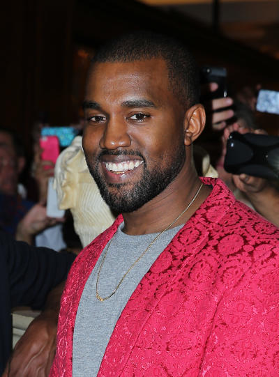 Kanye West Actually Smiles
