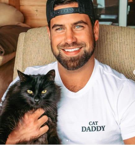 Blake Moynes and a Cat