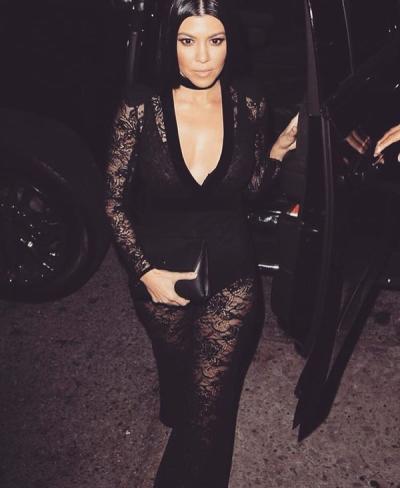 Kourtney Kardashian in black lace outfit