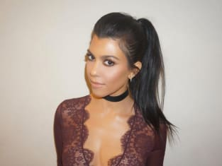 Kourtney Kardashian in lace top