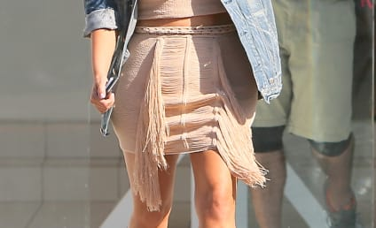 Kim Kardashian Rocks Crop Top, Possibly Reveals Baby Bump