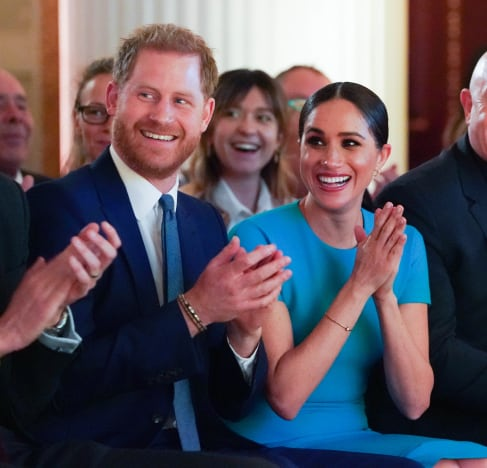 Meghan Markle and Prince Harry Clap