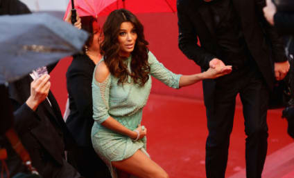 Eva Longoria Wardrobe Malfunction Heats Up Rainy Cannes