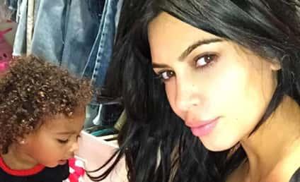 Kim Kardashian Shows Off Cleavage, Cute Daughter