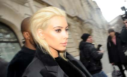 Kim Kardashian Flaunts Huge Boobs, New Blonde 'Do in Paris